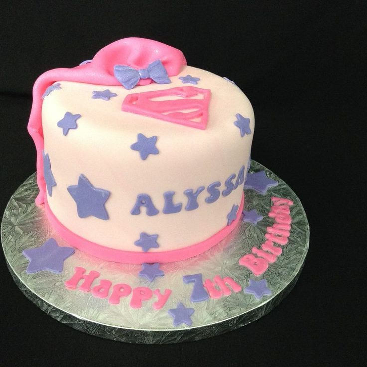 Pink SuperGirl themed cake decorated by Coast Cakes Ltd