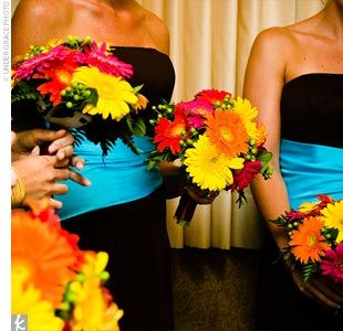 Jessica's eight bridesmaids wore Mori Lee strapless A-line gowns in chocolate brown. The blush-hued asymmetrical wraps the dresses came with were replaced with bright turquoise ones to match the wedding's colors.