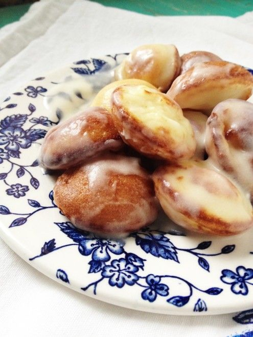 Glazed Aebleskivers: This Danish dessert is a cross between pancakes and donut holes that are baked in a special pan and doused with sweet glaze.