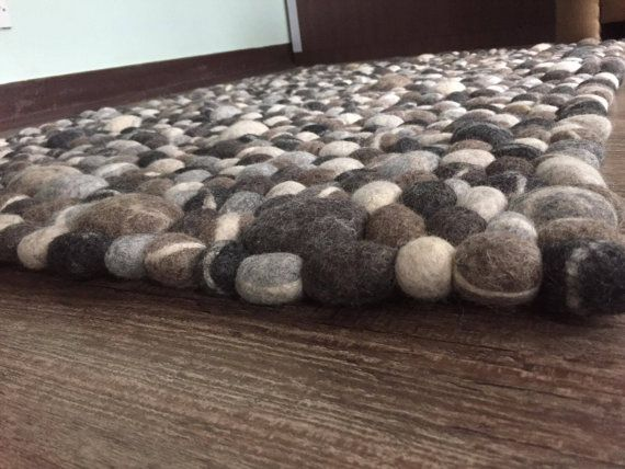 Normal stone pebble sorts felt ball carpet in dark and light tone. We have utilised 100% New Zealand normal fleece to make this superb floor covering. Its made of undyed regular fleece, free from all chemicals. Every ball in this mat is hand sewed separately, they are not stuck so its entirely solid and simple to keep up. Our felt ball floor coverings are non harmful and sensitivity free. Its size is 100cm by 140cm. We profoundly prescribe launder and delicate vacuum cleaning for this floor…
