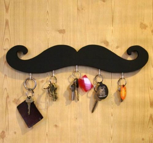 Make your own Mustache Key holder!  Cut out mustache design from a piece of plywood and paint any color you want!