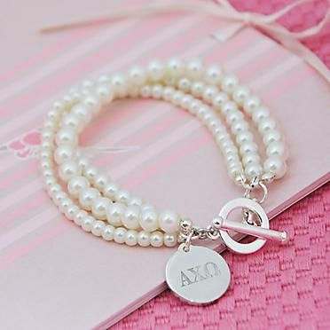 so cute and classic. every sorority girl needs her pearls