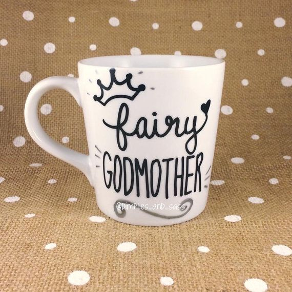 This listing is for one white, high-quality, sturdy porcelain coffee mug with fairy godmother written in black with a crown and silver details.