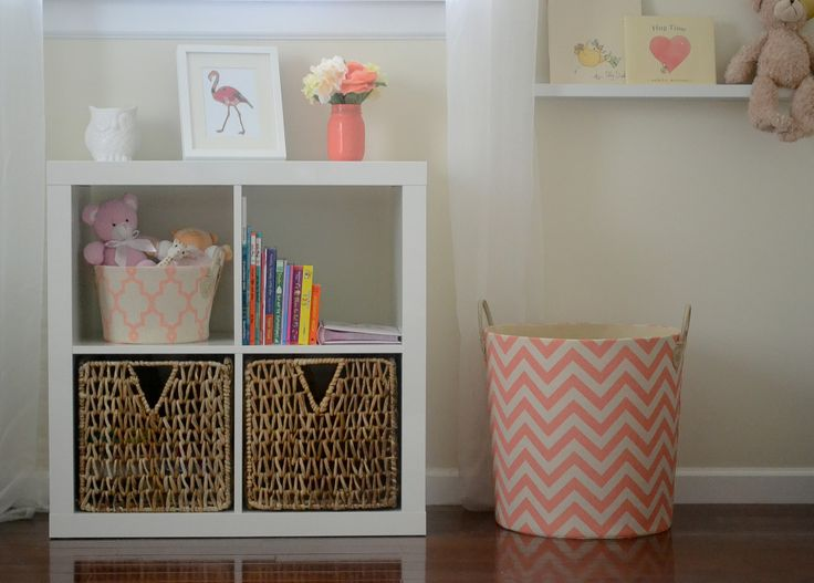 Be sure to buy pieces that double as storage - we love this cube, which can hold books and bins, but also display fun decor! #nesting: Coral And Gold, Ideas, Coral Gold Nurseries, Projects Nurseries, Chevron Baskets, Coral Storage Cubes, Baby Rooms, Baby Bedrooms, Baby Nurseries