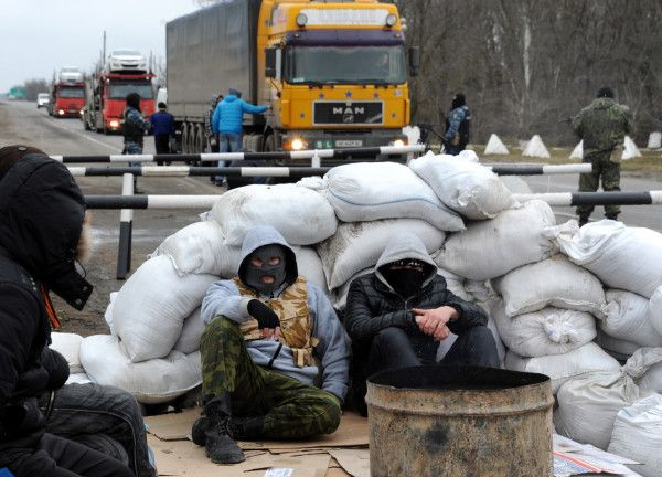 PHOTO: Crimean pro-Russian separatists blocking a road 28 February 2014