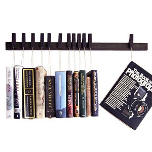 Wenge Book Rack, #Cue Danish design duo agustav and their innovative shelves that turn tomes into artworks hung on display. Re-frame your library in 2013.