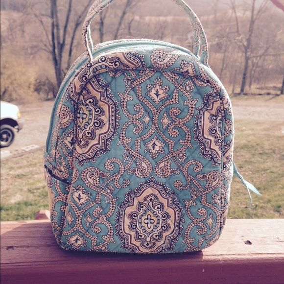Vera bradley Lunch Box Pre owned used by my daughter for a year.  Staining inside, see pictures. Outside looks nice    Not perfect  No fraying of handles or  scuffed material. Selling cheap!!! Teal/tan/brown Vera Bradley Bags