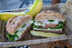 Einstein Bagel's Hummus Veg Out Sandwich Hummus, Tomato, Red Onion, Spinach, Arugula, Roasted Red Peppers, Cucumber with Garden Veggie Shmear on a Fresh-Baked Multigrain Roll