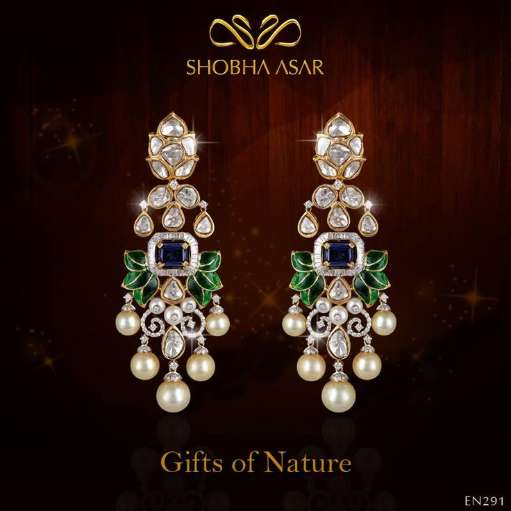A uniquely crafted pair of earrings in 18kt yellow gold, inspired by peacock colours with a fusion look using uncut and round brilliant cut diamonds and fresh-water pearls