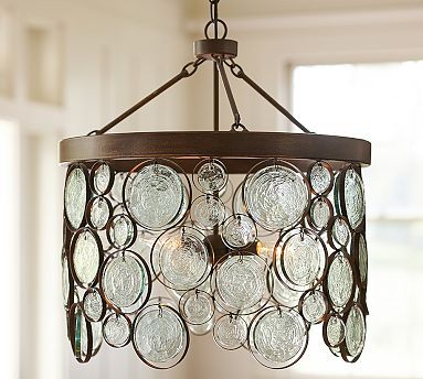 "Emery Recycled indoor/outdoor glass chandelier 21"" diameter, 24.5"" high Handcrafted of recycled glass and wrought iron; waterproof ceramic socket with phenolic cover."