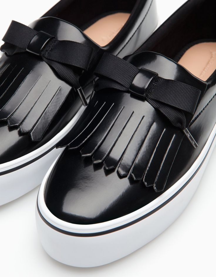 Slip ons with fringing detail