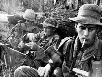 Steve Northup of United Press International used this Leica M-2 camera to capture this 1966 photograph of UPI correspondent Martin Stuart-Fox, center, and Time-Life photographer Tim Page seeking shelter during a firefight. Credit: Steve Northup (PRNewsFoto/Newseum)