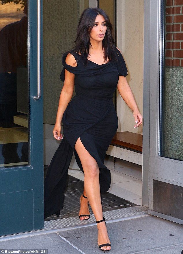 Getting there! Kim was spotted heading out to the awards show in her racy outfit