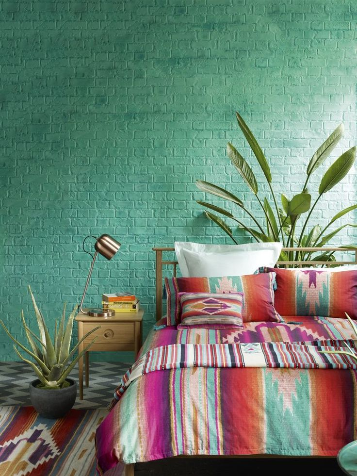 Inspired by the hot colours and exuberant patterns of South America, this bedroom decorating look is both vibrant and uplifting. Tip: Mix and match contrasting bold hues to create the look. Copper, still a big trend this year, will also work well with these hot colours. (Photo: Marks & Spencer). Find more inspiration at housebeautiful.co.uk