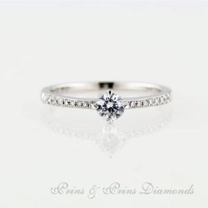 18k white gold ring with one 0.31ct G VS Round Brilliant Cut diamonds with 18 = 0.15ct round brilliant cut diamonds micro set in the band. 1R06351