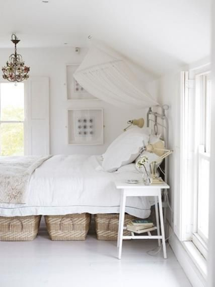 Natural modern interiors- How To Decorate – The Modern Country Style – modern country bedroom interior with lots of white- white timber floor boards- white bed linen and feature timber storage baskets-