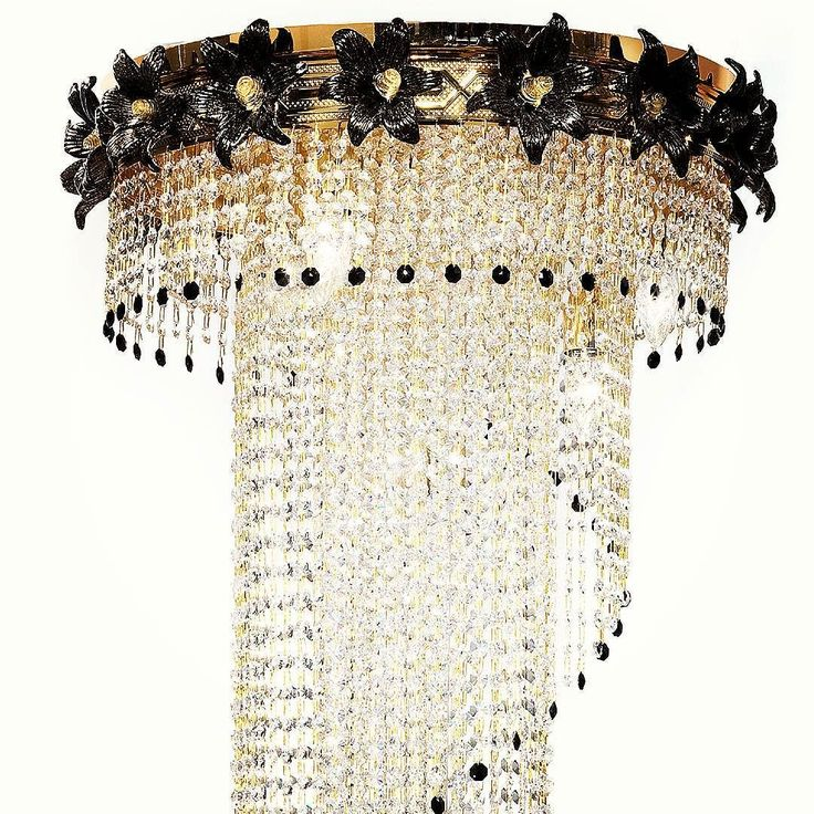 Lucent #CrystalChandelier by #ILParalumeMarina is made of tiny #crystals draped to look like a womans falling #satin gown. With a lining in black Murano #glass flowers on the top the chandelier also has black gems that outline the fall of the crystals giving it a beautiful border. A perfect piece of #lighting for #luxurylivingrooms. #hotelfurniture #luxuryhomes #chandelier #crystallighting #suspensionlamps #ceilinglamp #modernlighting #contemporarylamps #lamps