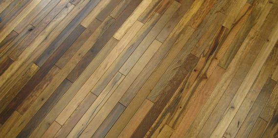 One line of wood pallet and crate flooring from Oregon-based Viridian Wood Products, Jakarta Market Blend, comes from the tropical lowlands of Asia with four finishes — Dark Sort, Light Sort, Tropical Mix, and Rustic.  The other, Fishtail Oak, has iridescent copper flecks with the slight look of a fishtail.