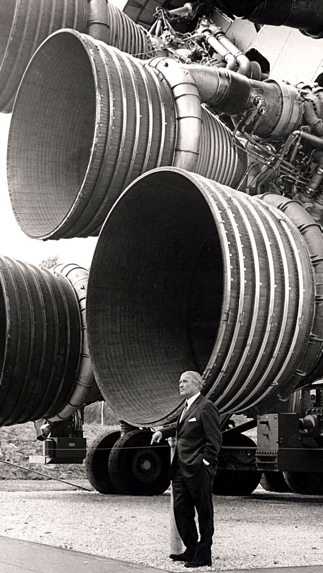 Rocket engineer Wernher von Braun in front of his saturn V engine