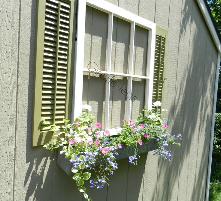 fake window, w shutters and flowers
