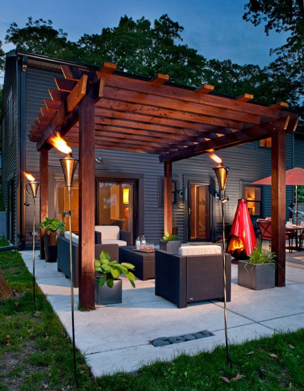 Marvelous Covered Concrete Patio Designs with Wrought Iron Garden Torches and Red Chiminea also All Weather Resin Wicker Furniture Under Outdoor Wood Pergola Designs of Patio Paving ~ Paver Patios on Paverpatioideas.com