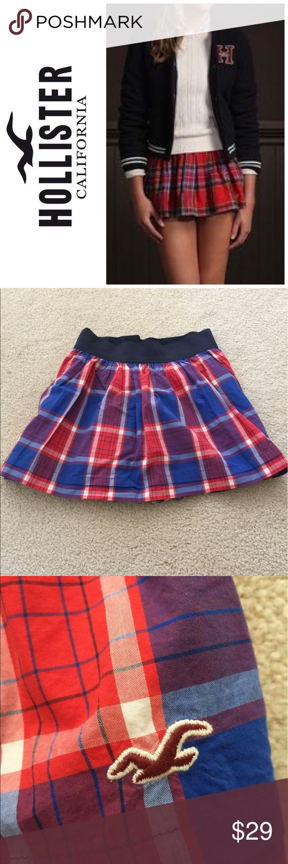 NWOT hollister plaid mini skirt Adorable plaid red and blue mini skirt from hollister. It really channels your inner school girl vibes lol. 😍🦋Never worn. Has an inner lining to that the skirt flows very well and is not see through. ‼️😍Selling to pay off student loans so make me an offer!!💞🎉 stock photo shows same skirt in different color. Actual skirt is pictured below Hollister Skirts Mini