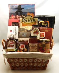 """An array of favourite Canadian products - all """"Made in Canada"""". Flavours from coast to coast are included in this array of Canada's best! This basket may Include:: PURE Maple Syrup, SEA CHANGE Smoked Salmon Pate; SEA CHANGE Maple Glazed Wild Smoked Salmon;Lesley Stowe's Raincoast Crackers, The Ultimate Bean Coffee, Vincenzo's Homemade Pasta, Turkey Hill Maple Cream Cookies, Rogers Dark Chocolate ,Kitchen Connoisseur Tomatoes, Sun Dried Tomatoes;VincenzosSauce; Greaves Pure Jam, C..."""