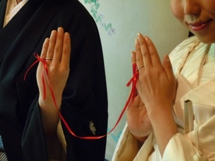 Japanese legend of soulmates being tied together with a red string