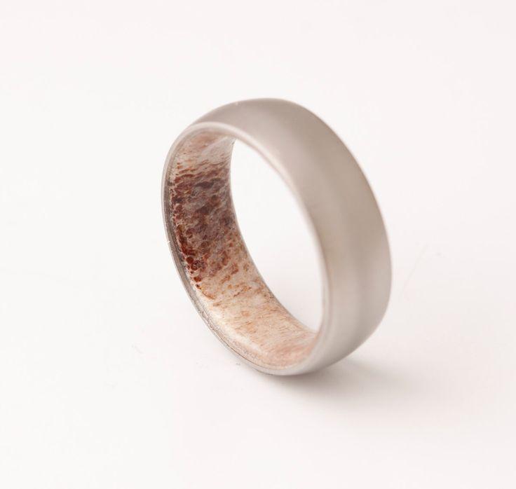 Antler ring // titanium antler ring //Antler Wedding Band // antler man woman ring by dimaltagioielli on Etsy https://www.etsy.com/listing/269277275/antler-ring-titanium-antler-ring-antler