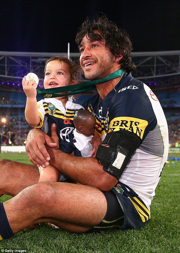 Cowboys captain Johnathan Thurston takes a moment in the centre of the field with his daughter Frankie Thurston after winning the 2015 NRL Grand Final