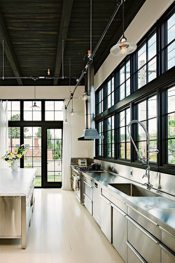 Modern kitchen all stainless steel with black windows