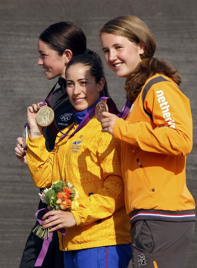 Day 14 - Gold medallist Colombia's Mariana Pajon, silver medallist New Zealand's Sarah Walker (back L) and bronze medallist Laura Smulders (R) of the Netherlands walk during the women's BMX victory ceremony during the London 2012 Olympic Games at the BMX Track in the Olympic Park August 10, 2012. REUTERS/Paul Hanna
