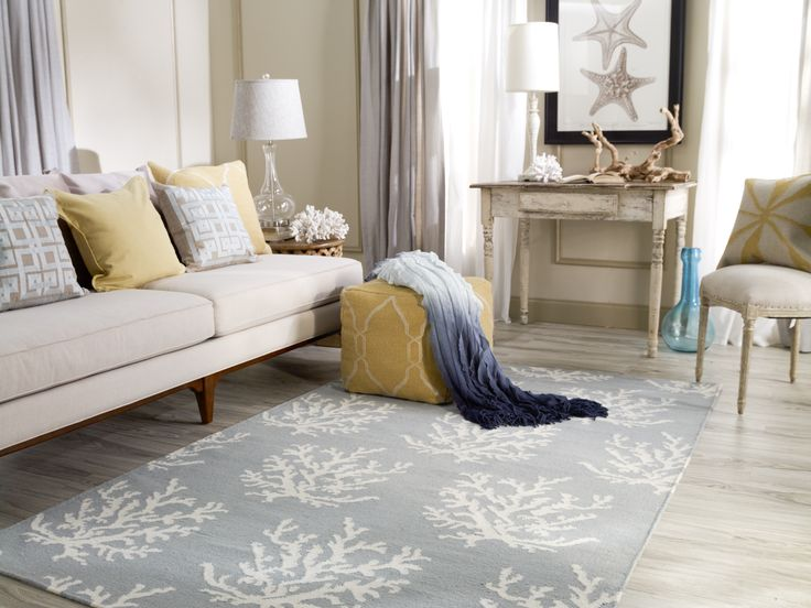 Wow! What a staggeringly versatile & beautiful area rug by Surya! Gorgeous muted tones allow this rug to pair with virtually any décor. The featured sea theme adds a calming natural beauty that you just won't get from common modern motifs.