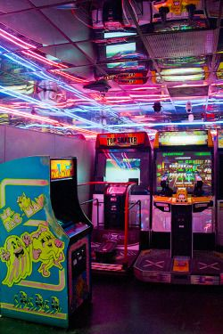 | There was one arcade. They never actually played the games. Just sat in the corner, the neon lights flashing on their skin. |