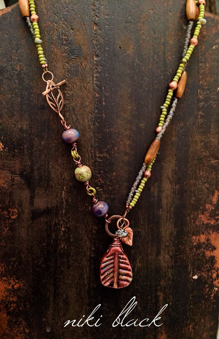 Made this necklace using a ceramic pendant, Czech glass beads, wooden beads, a @gaeabeads ceramic bead and more.
