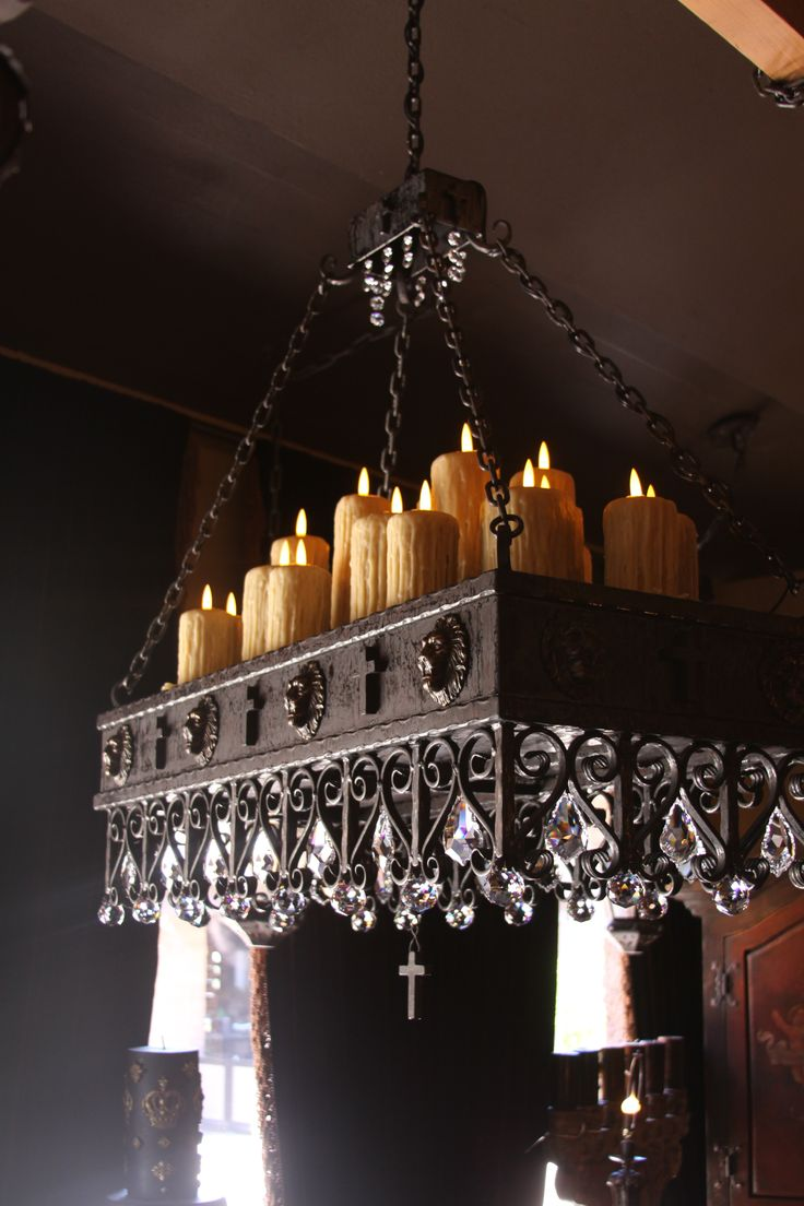 Not keen on the crucifixes, but everything else works beautifully. (Arts Of… I thought the crystals were wine glasses before I clicked on it. That could be fun. Iron chandelier with candles on top that doubles as a glass holder