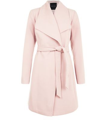 """In a sweet pink hue, this luxe wrap coat is the ultimate versatile, wardrobe investment. Layer over both day to night looks effortlessly.- Simple long sleeves- Wide collar- Soft finish- Belted waist- Model is 5'8""""/176cm and wears UK 10/EU 38/US 6"""
