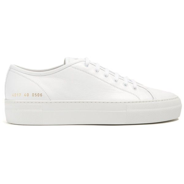 Common Projects Tournament low-top leather trainers ($283) ❤ liked on Polyvore featuring shoes, sneakers, metallic gold sneakers, white low top shoes, metallic gold shoes, white leather trainers and leather trainers