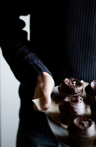 Chocolate Cupcakes w/ Chocolate Frosting-- lovely lighting and sweater and cupcakes. :)