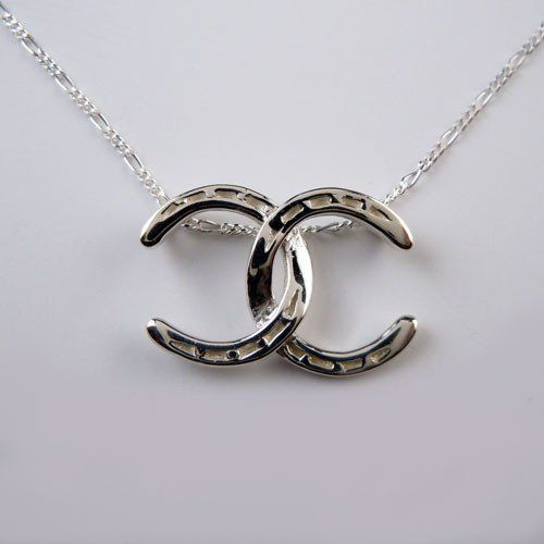 Sterling Silver Double Horseshoe Necklace, sure looks like a famous designer's logo doesn't it?!?! Two perfectly detailed Horseshoes entwined together create a unique Horseshoe necklace that you will