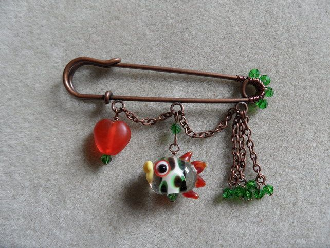 Orange and green fishy kilt pin £6.50