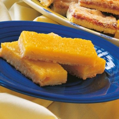 Pale, pretty and with a penetrating citrus tang, these slim golden bars combine the delicious texture of lemon honey with a crisply tender biscuit base