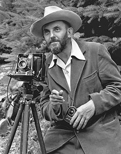 Famous actors with Their Cameras | photo of a bearded Ansel Adams with a camera on a tripod and a light ...