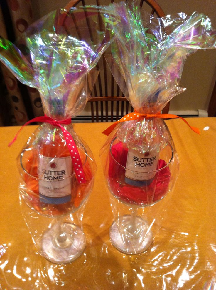 DIY  inexpensive Party favors- dollar store wine glasses with the stem and base painted with Martha Stewart glass paint, add colored tissue paper and a small bottle of wine finish it up with cello paper and matching bow. It's the gift that keeps on giving.
