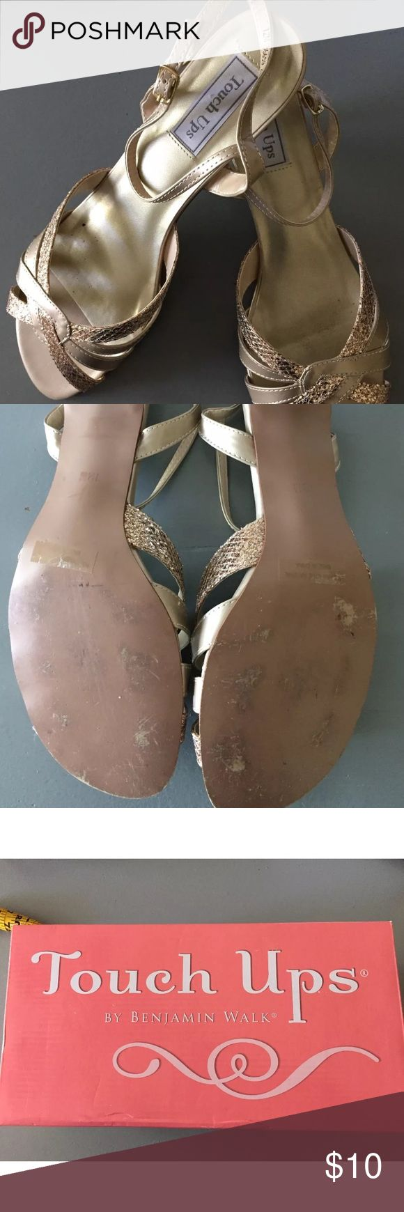 Gold strappy sandals in hard to find size 12 Worn once to a wedding.  On ground and concrete so the bottoms do show some wear.  Tops are in perfect condition.  The inside sole does show some rub off of the color at the ball of the foot.  I think this is pretty normal on metallic colored shoes. 1 3/4 inch heals. Please see pics for measurements.  The original owner wears a size 11, could not find the right color for her dress in an 11 and purchased these.  Because they are sandals with…