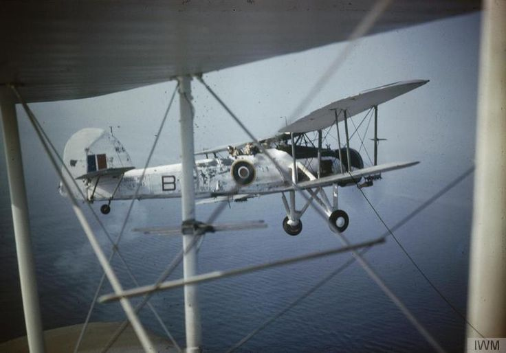 Close-up of a Fairey Swordfish Mark II, HS 545 'B', in flight as seen through the struts of another aircraft, probably while serving with No 824 Squadron, Fleet Air Arm, 1943-1944.