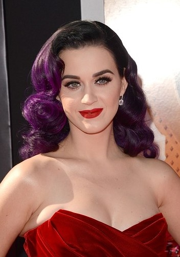 Katy Perry achieves her take on old Hollywood hair with a dark purple tint.