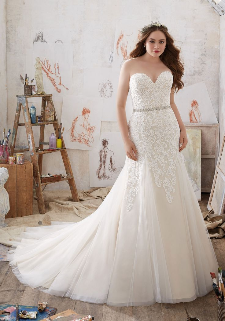 Glamorous Fit & Flare Wedding Gown Features Frosted Alençon Lace AppliquéŽs on Net. A Crystal Beaded Waistband and Soft Godet Pleats Add a Romantic Touch