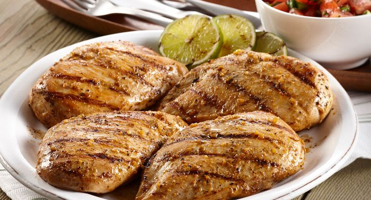 Grilled Mojito Lime Chicken with Fresh Tomato Salsa: Fresh Tomato Salsa is a lively accompaniment to grilled chicken breasts that's been marinated in the bold new Grill Mates® Mojito Lime...