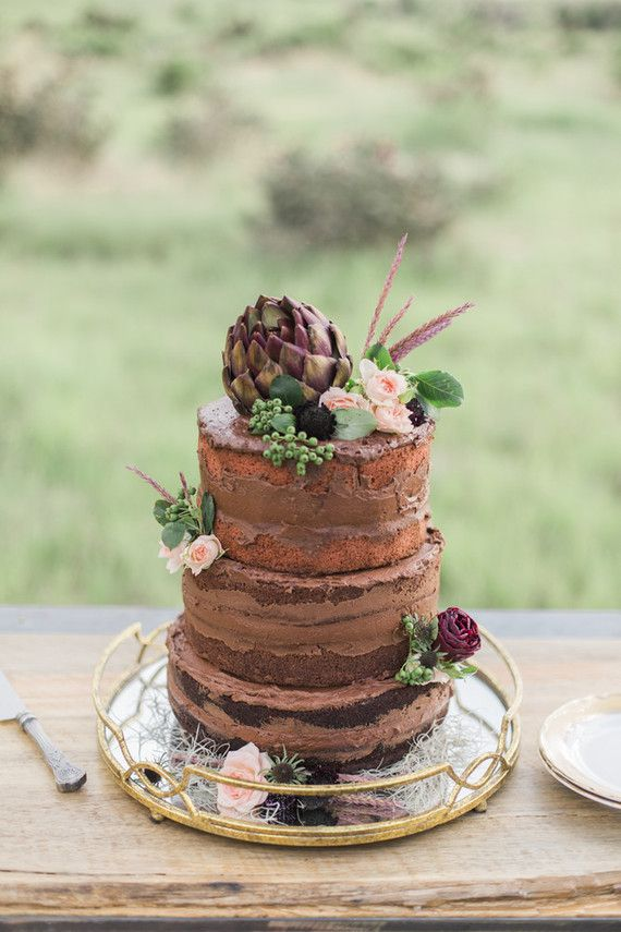 Naked cake with florals and greenery